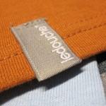 ledouche* clothing tag.